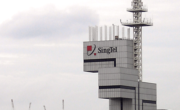SingTel Tower carries the old logo (and name).