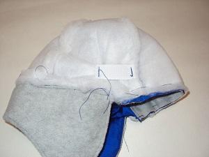 резинка в шапке-ушанке