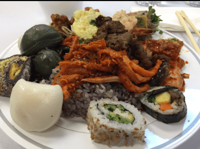 Trying all the new foods at a Korean wedding