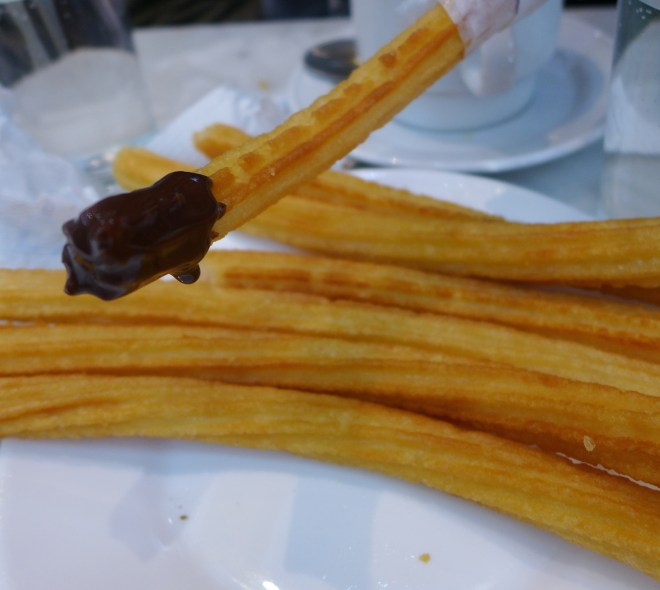 Delicious churros dipped in a rich hot chocolate sauce. San Gines Chocolateria.