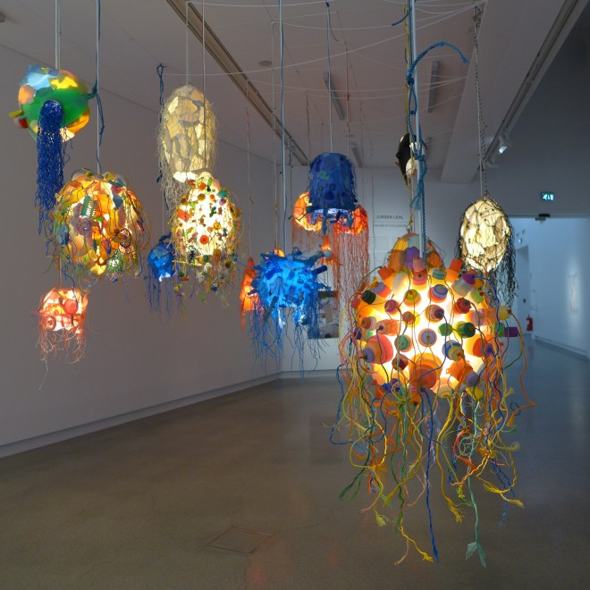 Lamps made out of trash that was collected on the beaches of Okinawa.