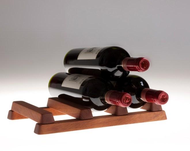 Vinetta, a fold up wine rack made from Mahogany.