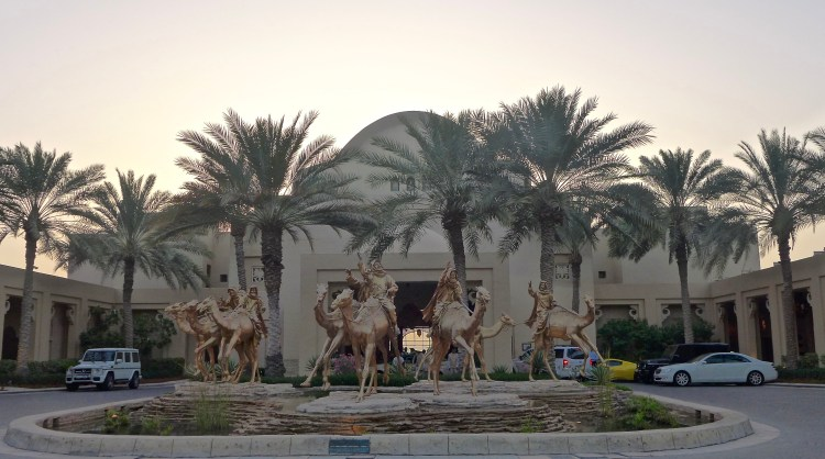 The Royal Mirage One & Only Resort welcomes us with camels at sunset.