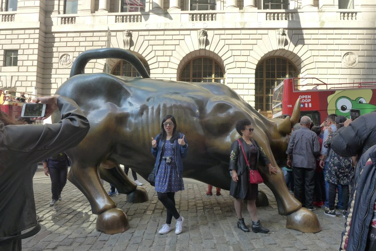 The Bull beseiged by Chinese tourists.