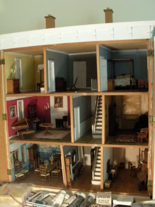 The inside of the dollhouse with the doors open