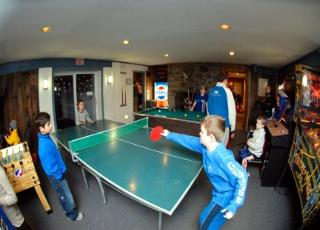 ping pong in Chimney Hill clubhouse game room