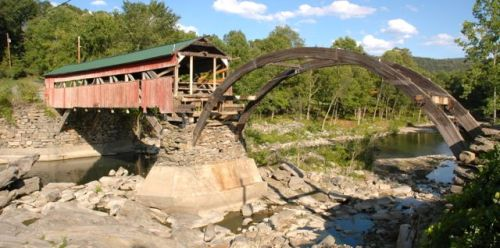 Footings and some structural parts of the historic Taftsville covered bridge were damaged by Irene. It's being restored but won't reopen until sometime in 2013. Photo by Andrew Nemethy