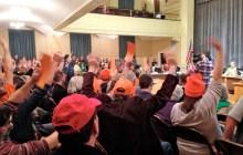 Opponents of Burlington's gun control resolutions wear blaze orange at a Burlington City Council meeting. Photo by John Herrick/VTDigger