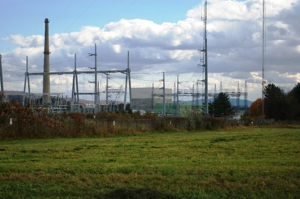 The Vermont Yankee nuclear plant is seen through the on-site power switch yard owned by VELCO, Vermont's transmission utility. Photo by Andrew Stein/VTDigger