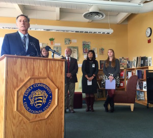 Gov. Peter Shumlin, flanked by students and local school officials, praises the Essex, Westford school district merger. Photo by Morgan True / VTDigger