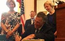 Budget signed into law, but uncertainty looms from DC