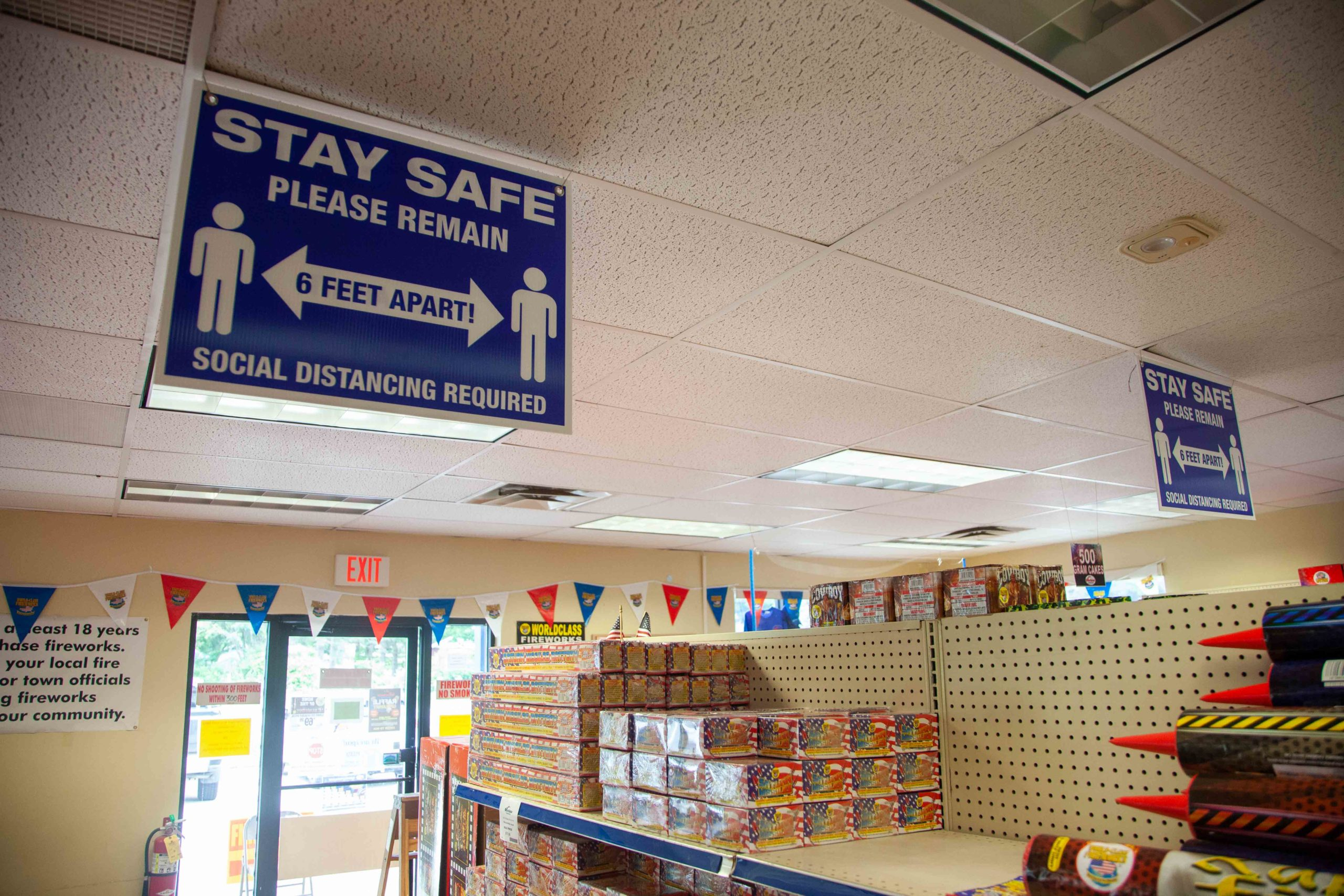 social distancing signs inside fireworks store