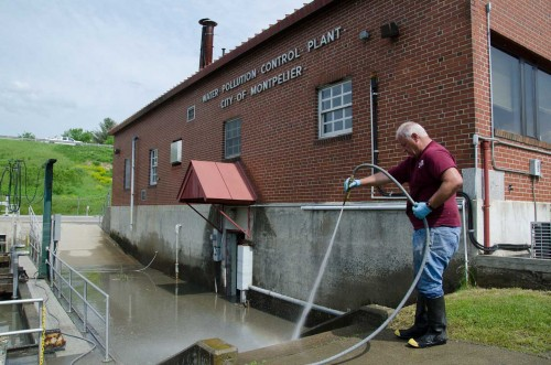 Plant Operator Jerry Smith hoses down steps outside Montpelier's waste water treatment facility. VTD/Josh Larkin
