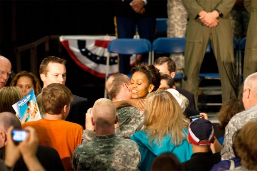 First Lady Michelle Obama hugs a Vermont National Guard member after speaking at the Army Aviation Support Facility at the Vermont National Guard airfield in South Burlington on Thursday June 30, 2011. Photo by Ian Thomas Jansen-Lonnquist