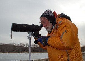 Ian Worley scans for birds along Lake Champlain at Shelburne Bay. This winter's invasion of snowy owls, he says, connects the open lands of Vermont to the Arctic tundra. Photo by Bryan Pfeiffer