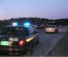 A Vermont State Police trooper makes a traffic stop.