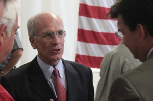 A variety of honored guests filed into the ceremony, including Congressman Peter Welch, seen here talking Ledbetter.