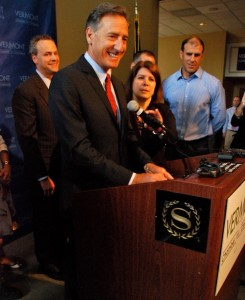 Gov. Peter Shumlin signing a patent abuse protections bill into law today at the Vermont Chamber Business and Industry EXPO in South Burlington. Peter Kunin, intellectual property lawyer at Downs Rachlin Martin, PLLC, to his right, Betsy Bishop, president of the Vermont Chamber of Commerce, to his near left, and Jerry Tarrant, chief financial officer at MyWebGrocer, to his far left. Photo by Johnny Herrick/VTDigger