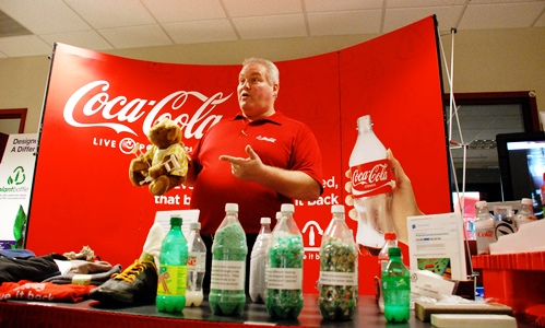 Ray Dube, sustainability manager for Coca Cola of Northern New England, showcases the company's recycling program during a presentation Thursday in Colchester. Photo by John Herrick/VTDigger
