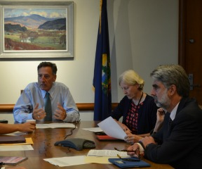 Gov. Peter Shumlin, left, addresses members of the Emergency Board on Wednesday, including Sen. Jane Kitchell, D-Caledonia, center, while Secretary of Administration Jeb Spaulding looks on. Photo by Alicia Freese/VTDigger