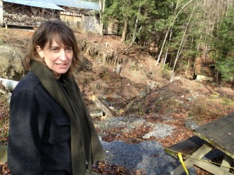 Erin Talmage, executive director of the Birds of Vermont Museum, stands at the edge of a ravine at the museum that was heavily damaged by a July flood. She says the museum will need $40,000 to repair the landscape. Photo by Candace Page