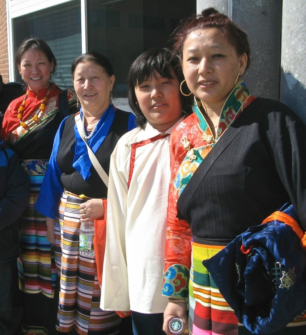 Members of Vermont's Tibetan community in traditional costumes pose outside the Fleming Museum in Burlington. Photo by Tom Slayton