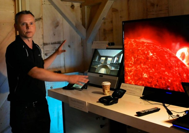 A representative demonstrates the power of wireless speeds that will be deployed in 2015: simultaneously streaming high-definition videos, teleconferencing and playing online video games without any wired Internet connections. Photo by Hilary Niles/VTDigger