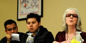 Abel Luna translates for Enrique Balcazar, both of the organization Migrant Justice, as Cheryl O'Neil of the Abenaki Heritage Garden, at a panel discussion on food justice at the fourth annual Farm to Plate gathering Thursday. Photo by Hilary Niles/VTDigger