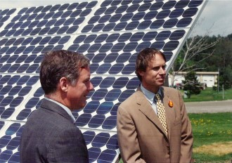 Leigh Seddon, right, joins Gov. Howard Dean in commissioning the state's first solar array in May 1994, at the General Services Center in Middlesex. Provided photo