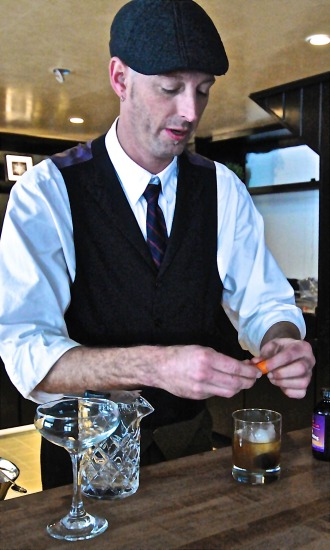 "Don Horrigan prepares the garnish for his ""Winter Old Fashioned."" Photo by Dirk Van Susteren"