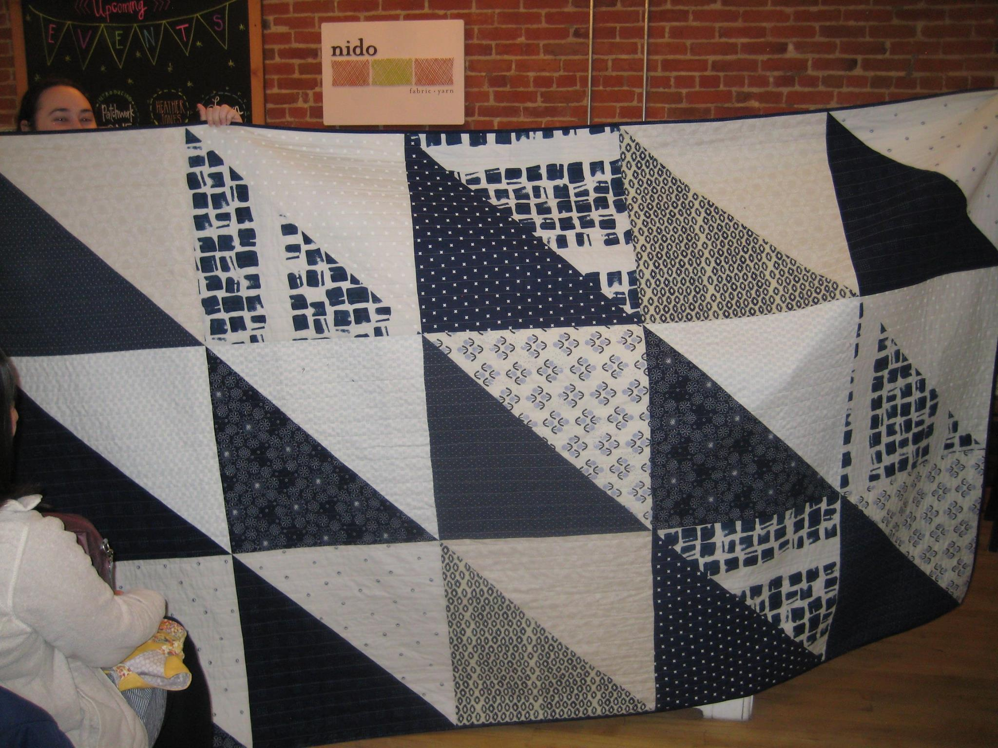 Blue and white quilt intended for Anya's son, but repurposed to decorate her bed.