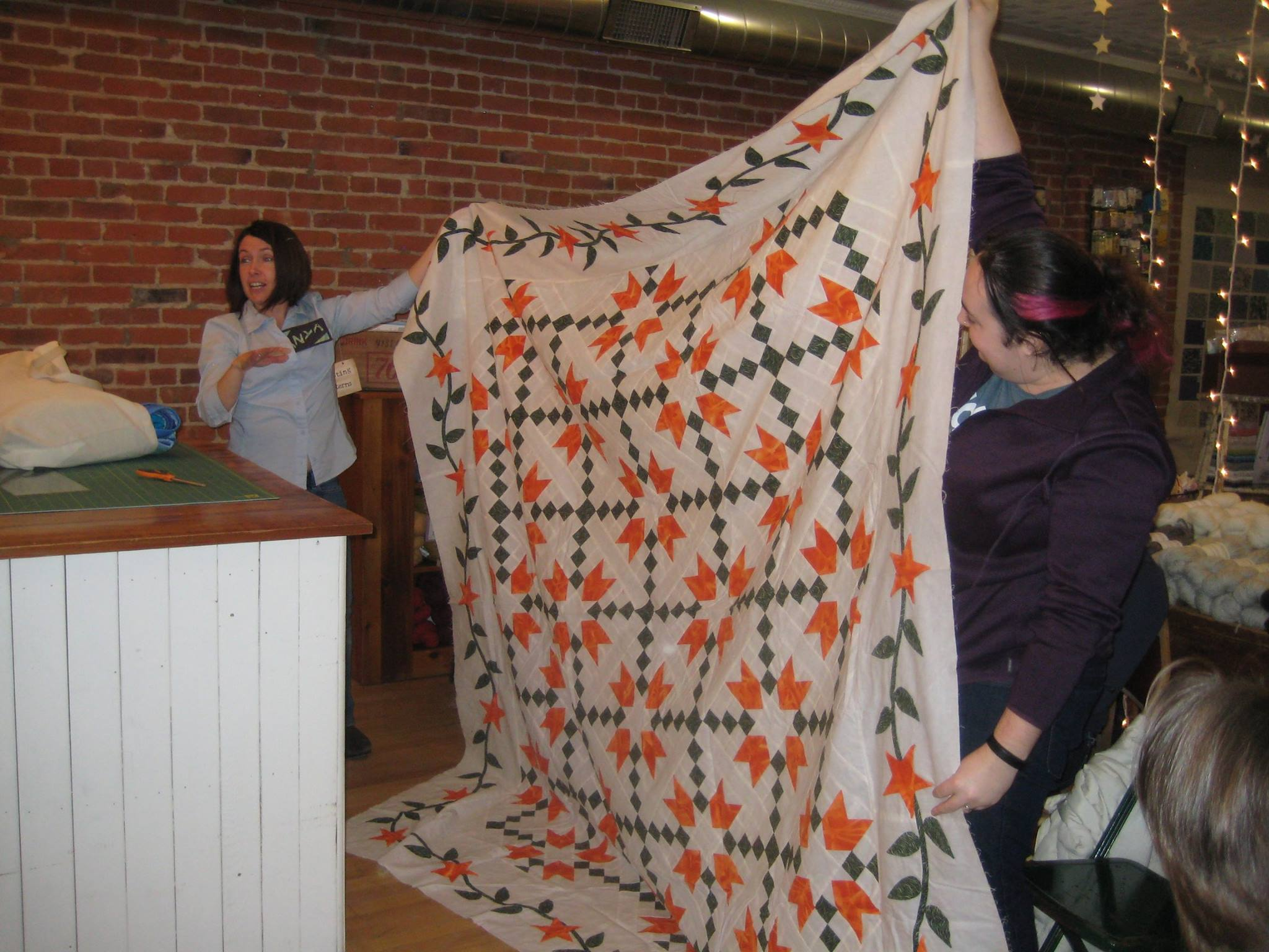 Anya's unfinished quilt top shows a traditional use of bias tape to form a vine in the border.