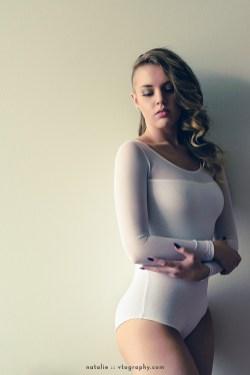 Natalie in white bodysuit