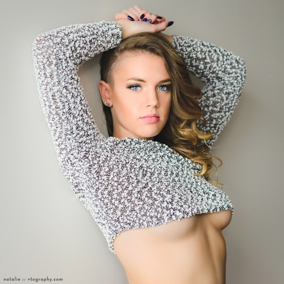 Natalie in crop top sweater