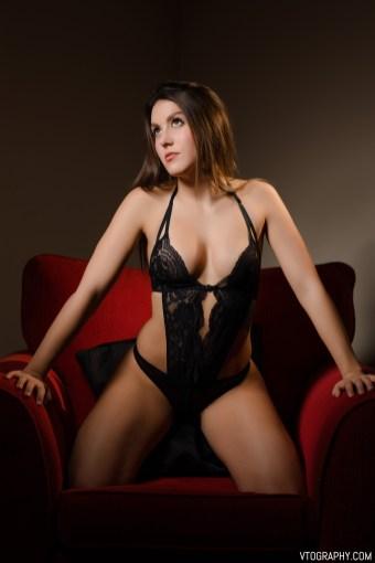 Victoria in black lace lingerie bodysuit
