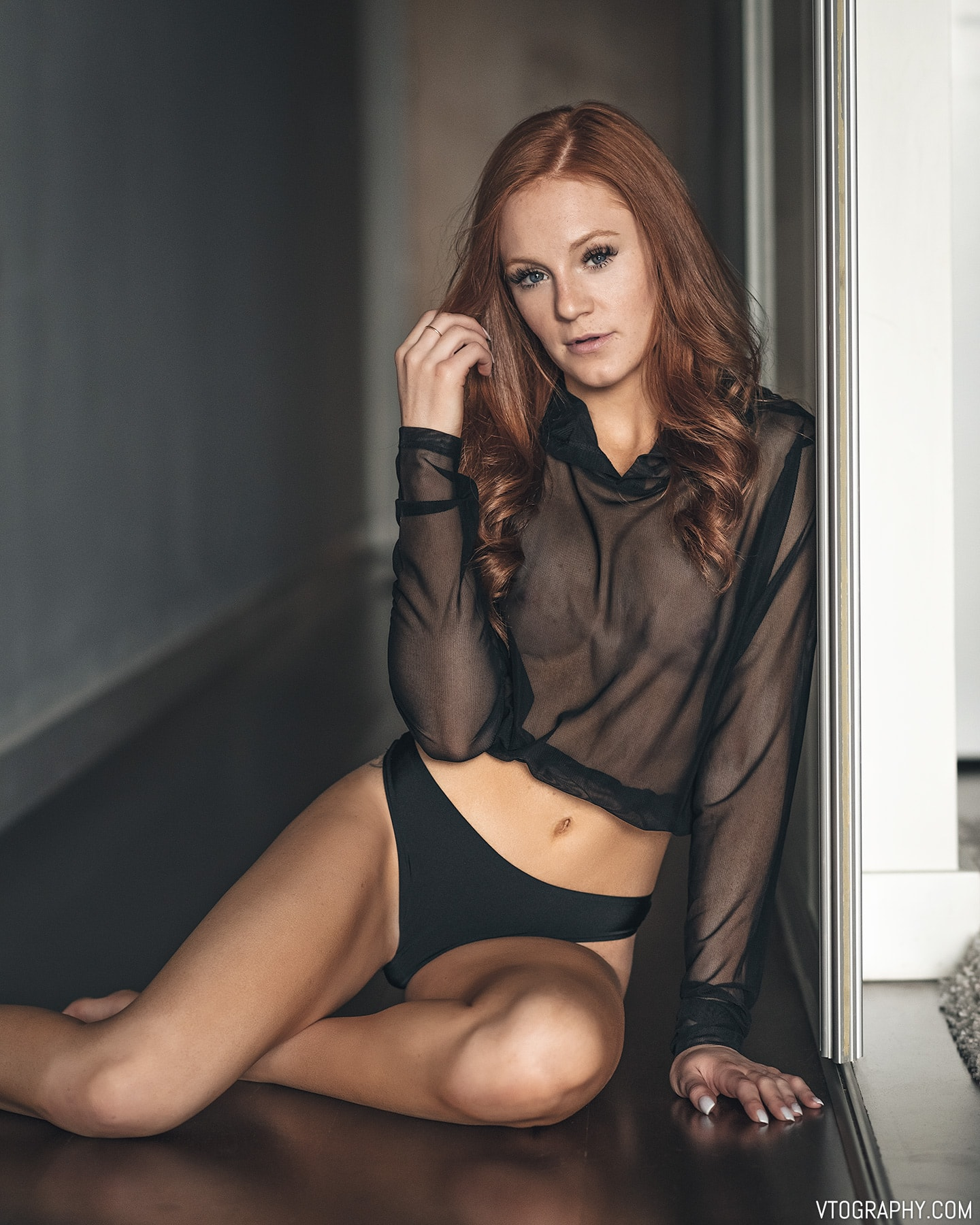 Redhead model Hannah in sheer black hoodie from Forever 21