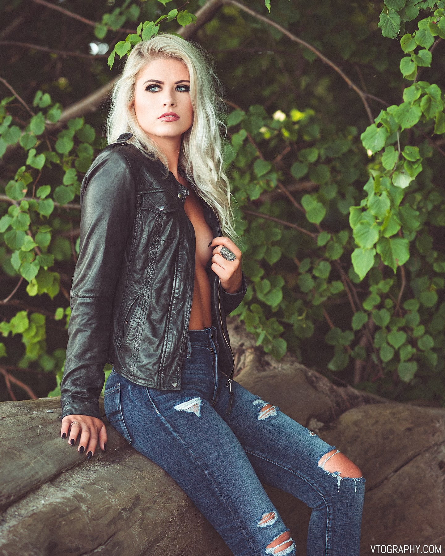 Model Sami wears a leather jacket and jeans