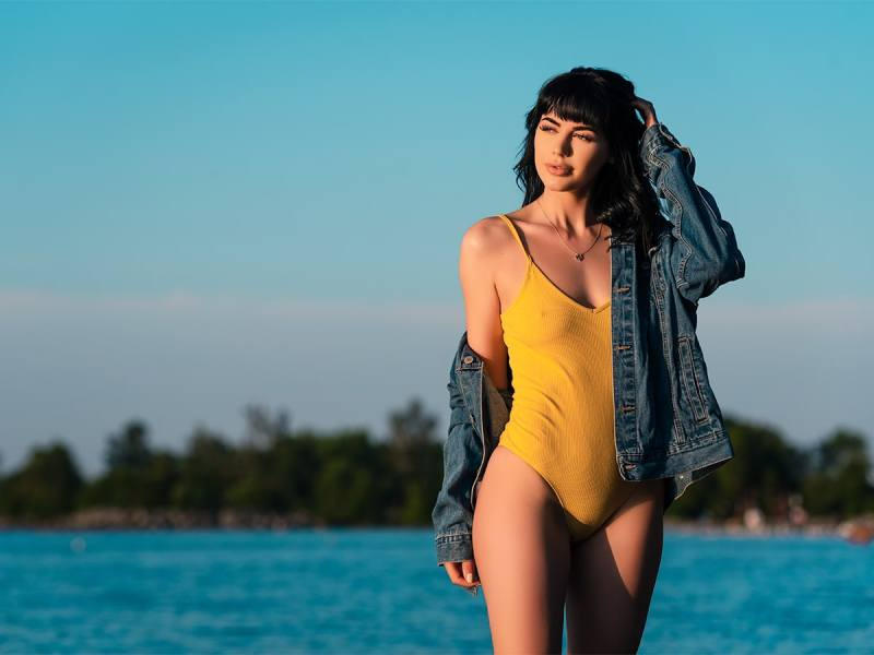 Model in yellow bodysuit at sunrise