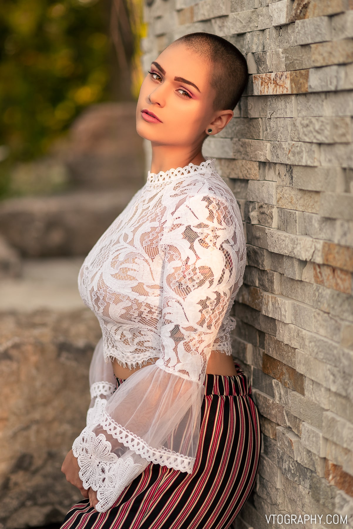 Singer Mela B wears white lace Urban Planet top during golden hour