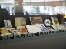 Exhibit case with Black Panther and American Communist Party pamphlets