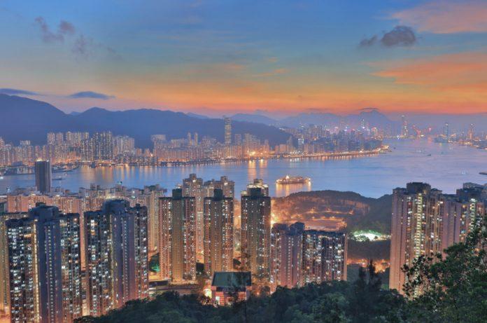 Hong Kong harbor and skyline seen at dusk.