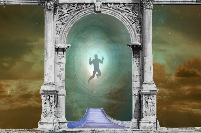 Artist's rendering of a body floating in the void approaching the light.