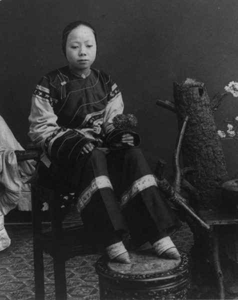 black and white portrait of chinese woman with feet bound