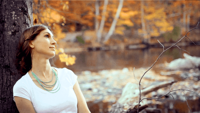 Katy Mantyk singer songwriter by river in fall