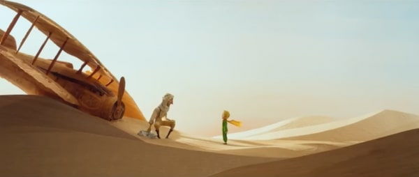 man by crashed plane in sahara desert faced with the little prince a blonde haired boy in green with a yellow cape