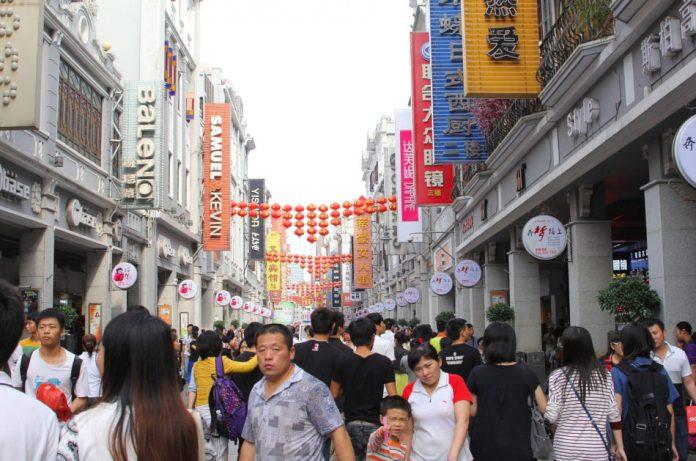 Main shopping area Shangxia Jiu Lu Pedestrian Street in the city center of Guangzhou, China.
