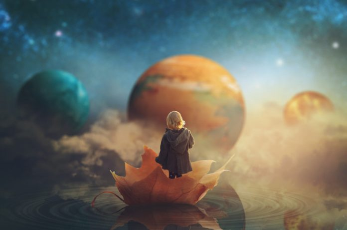 Little girl travelling through dream world, floating on a big fallen leaf.