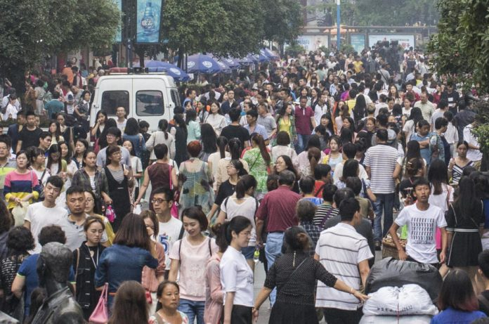 A crowd of people in a shopping district in Chengdu, China.