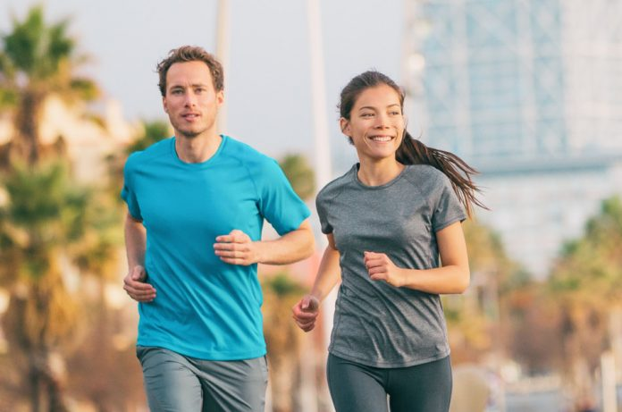 Young man and woman out jogging.