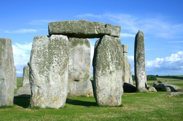 Stonehenge with blue sky and white clouds in the background.